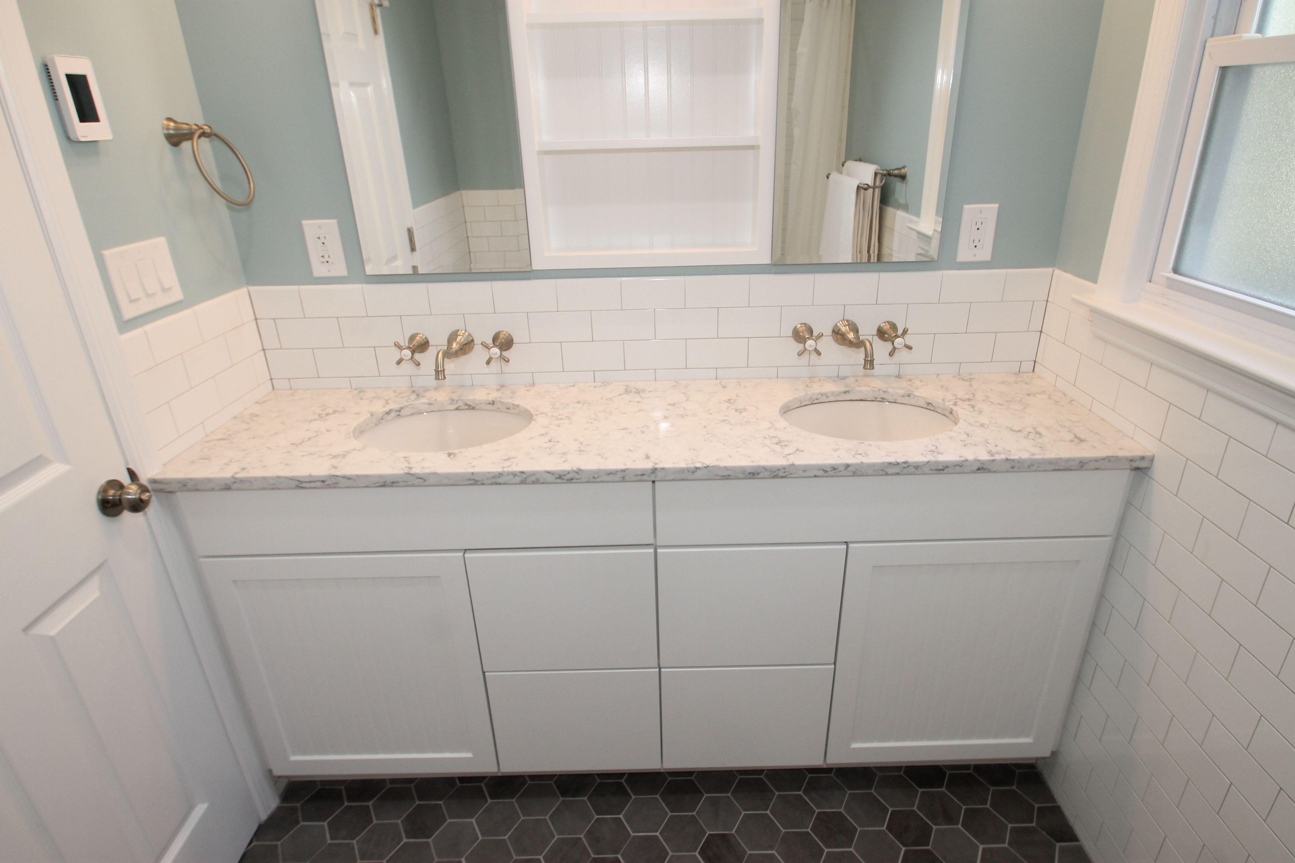 A classic white bath remodel makes a small space inviting