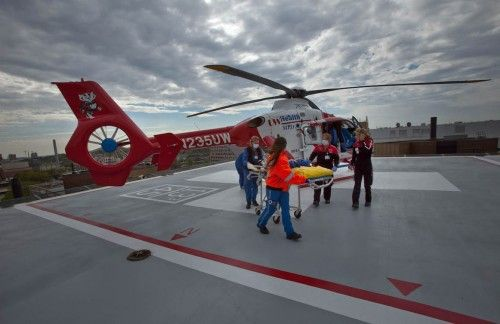 Crew members take a patient into UW Hospital after Med Flight picked the patient up at a hospital in Dubuque, Iowa, Wednesday morning. Pilot Mike Kohrs and three other crew members made the flight. #uwrightnow