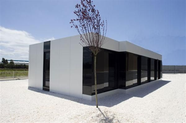Black And White Color Contemporary Sleek White Modular Small House Design  By A Cero