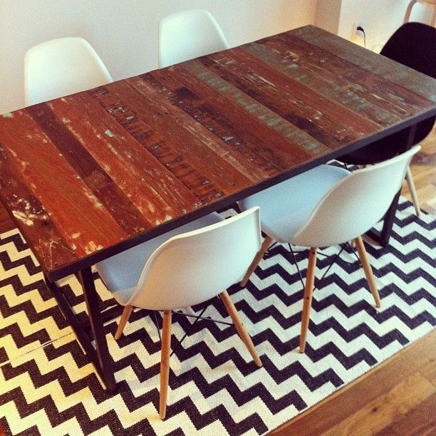 Dining Table From The Source And Woven Plastic Rug By