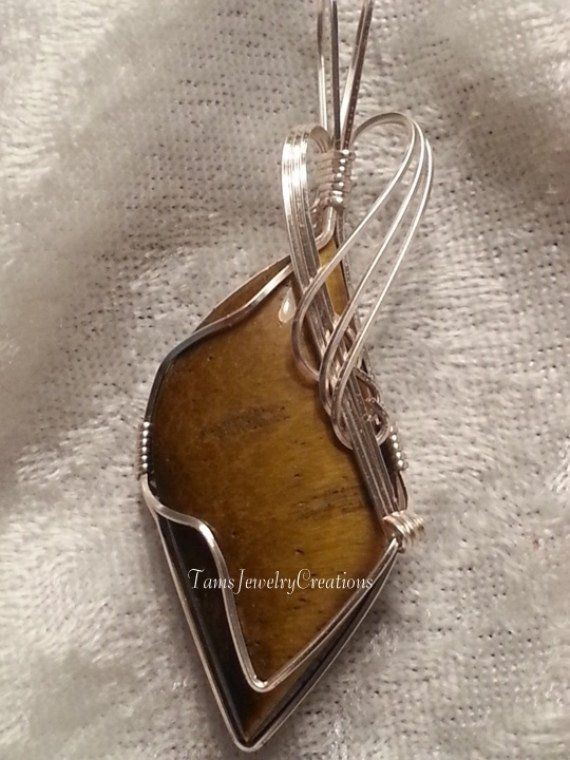 Photo of Tiger Eye Stone Cabochon Wire Wrapped Pendant
