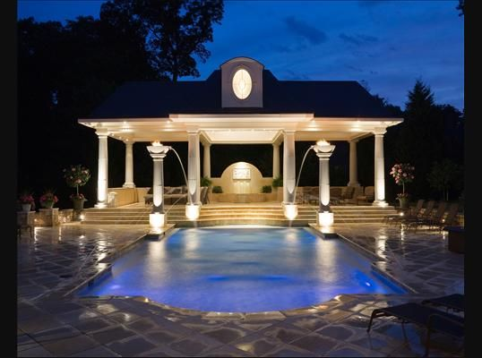 Beautiful pavilion and geometric pool with laminar fountains great lighting too