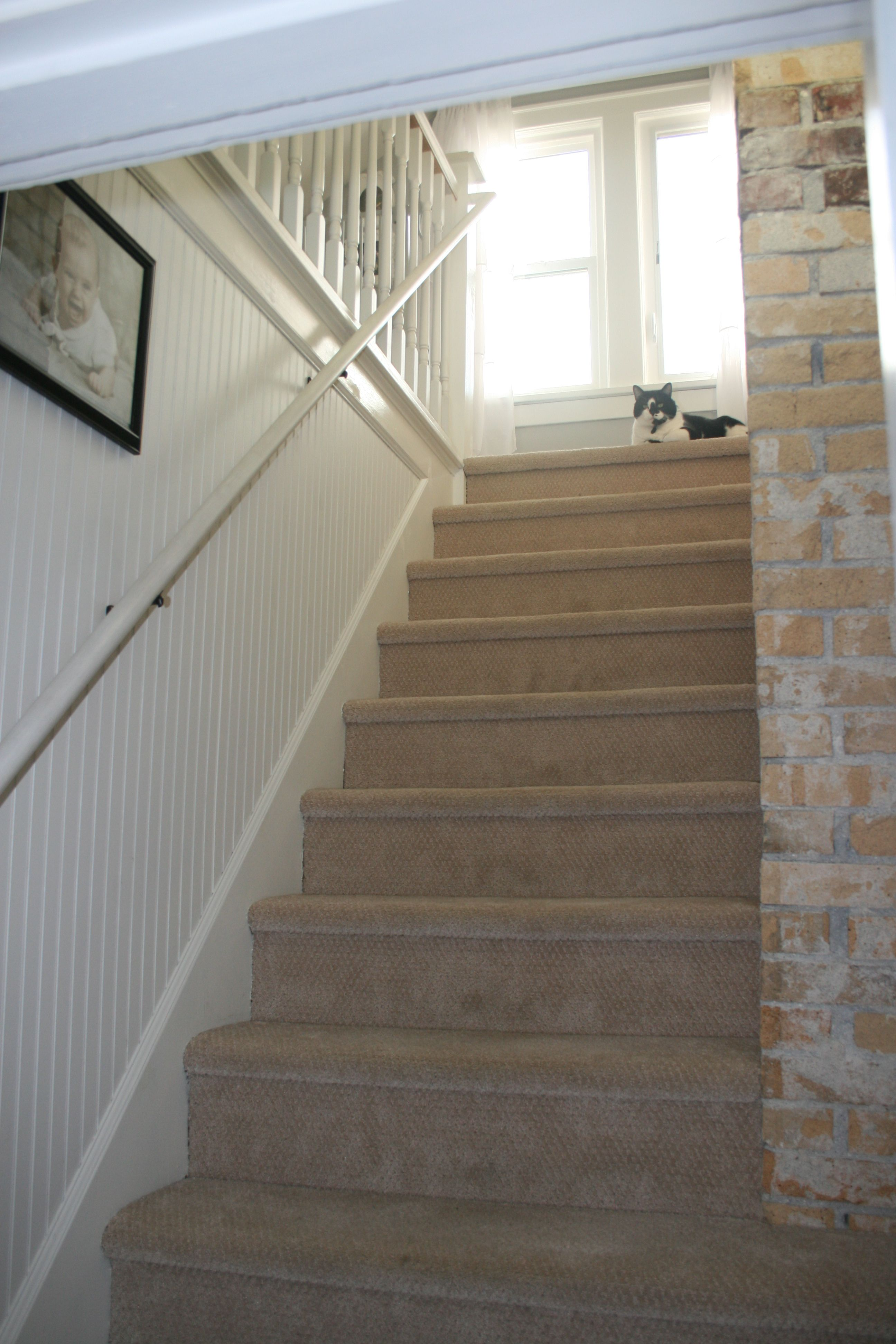 Bead board walls in the stairway. Craftsman Home renovation. Save ...