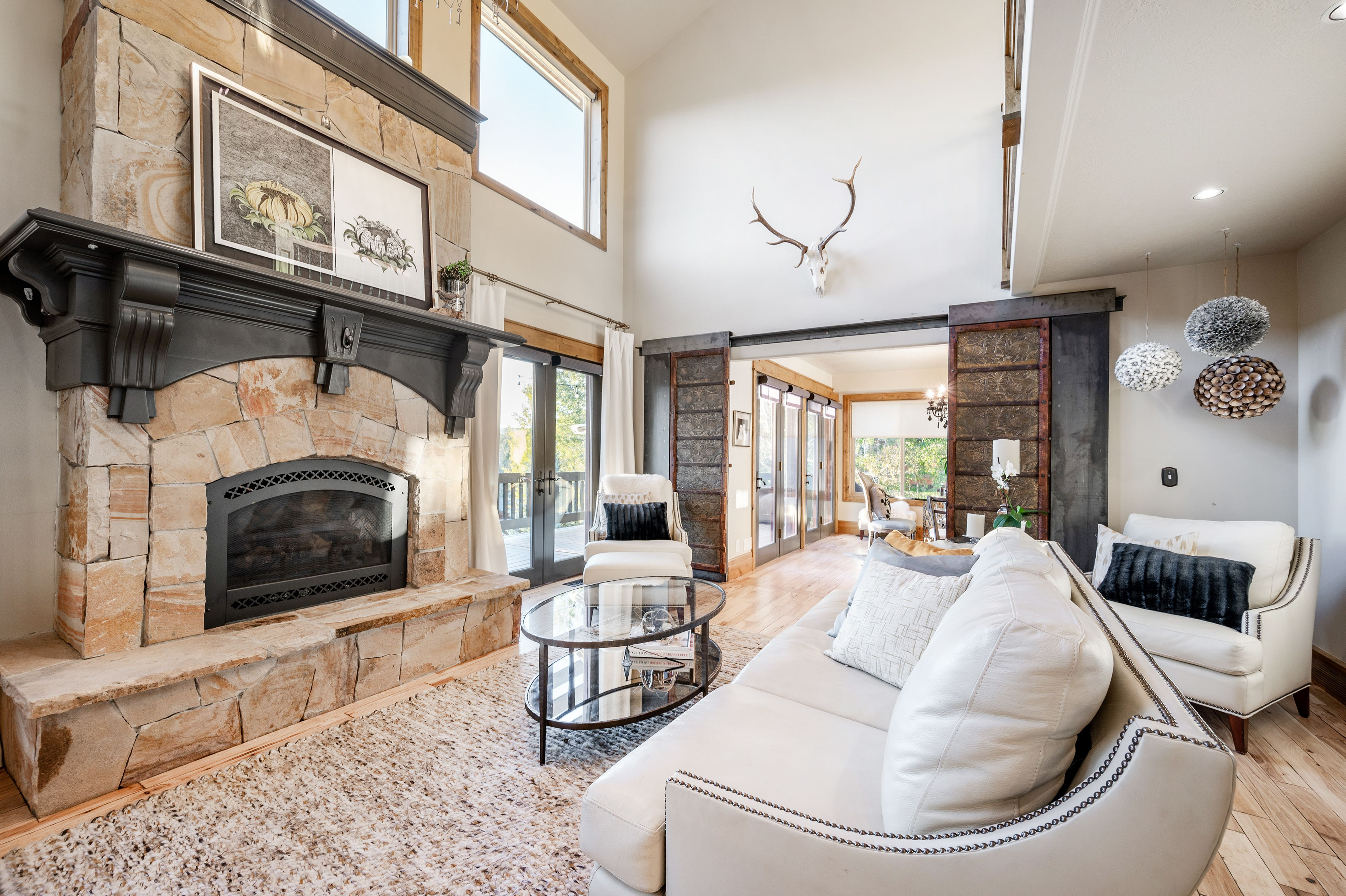Fabulous great room in a home with the ideal open-concept flow. #GreatRoom #WindermereUtah #LivingRoom #Fireplace #ParkCityHomes #UtahHomes #DreamHome #LuxuryLiving #Luxury #Comfy #Cozy #Neutrals #BarnDoors #Couches #Neutrals #HomeDesign #HomeDecor #Interior #Home #Design #Style #HomeStyle