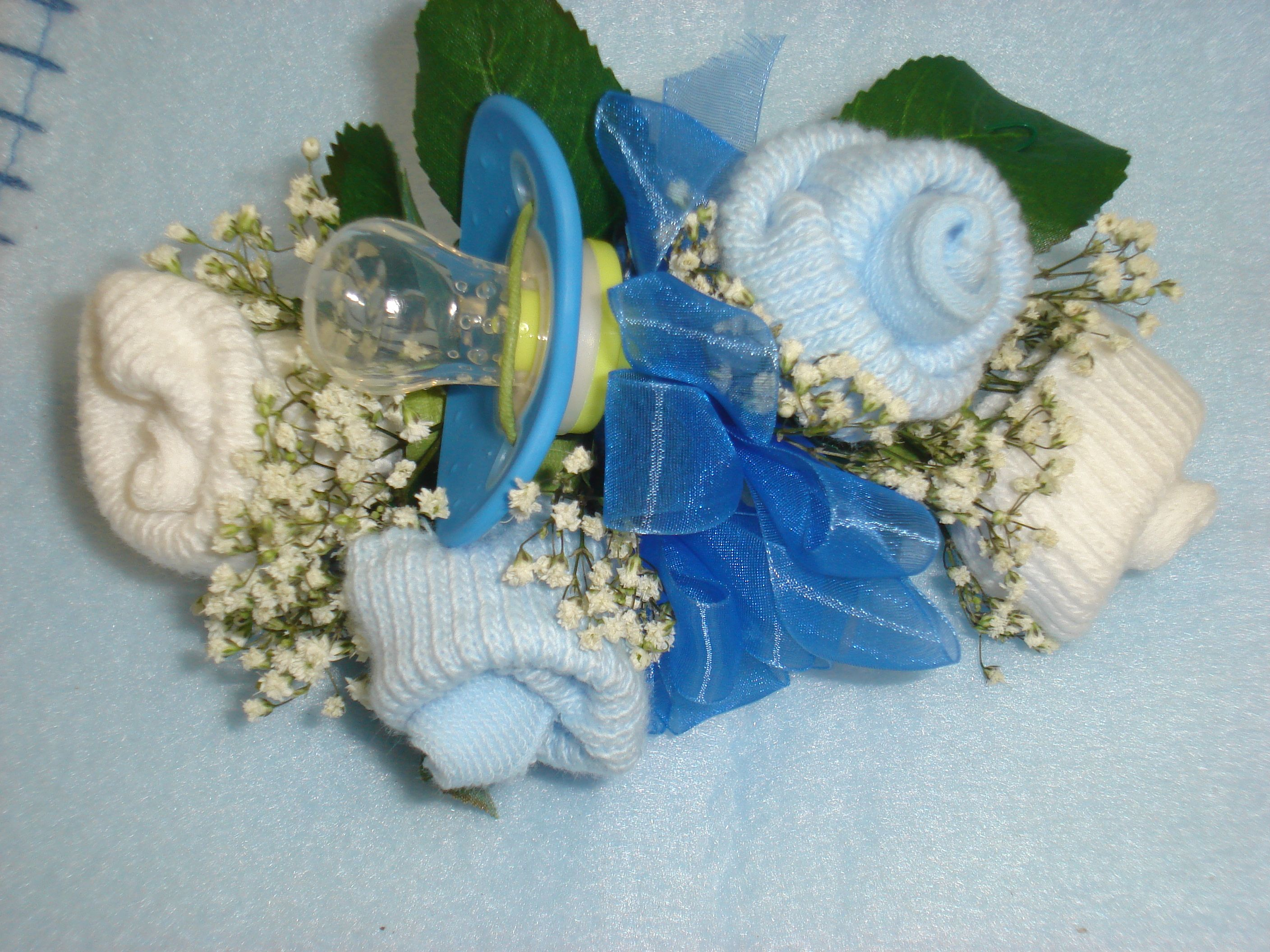 Add a pacifier to a baby sock corsage $16 95
