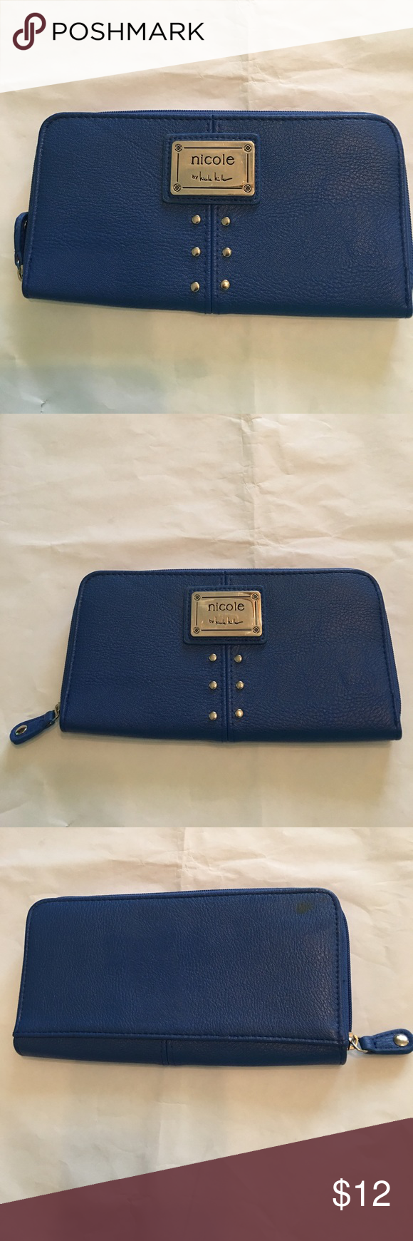 Blue Nicole Miller Wallet🛍 Blue Nicole Miller wallet, silver studded front, signature plate, card slots inside/outside zipper, *small spot in back shown in picture, not noticeable while carrying Nicole Miller Bags Wallets