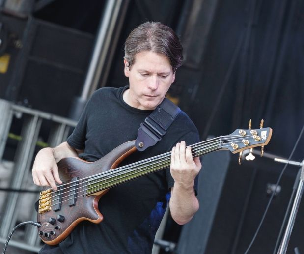 Sean Malone of Cynic performs at Heavy Montr‡©al at Jean-Drapeau Park on Sunday, Aug. 10, 2014. | Bass guitar, Cynical, Malone