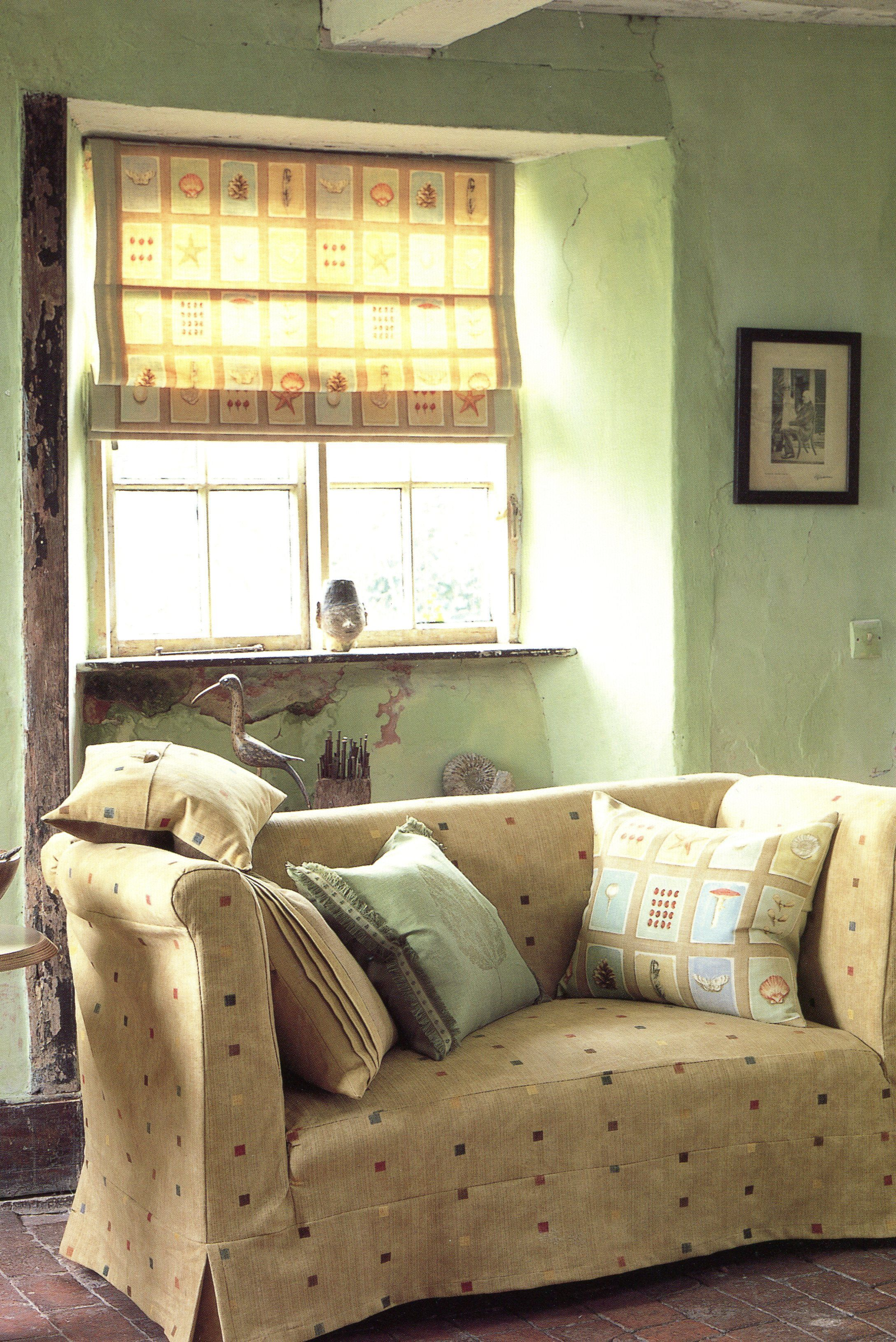 Rough, Rustic Walls Contrast With The Neat Tailoring Of A Roman Blind  Within The Recess And A Loose Sofa Cover.