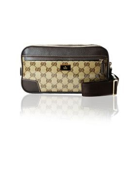 99966286a655 GUCCI Crystal GG leather Belt Bag in brown leather trim. Top zip closure.  Gold tone hardware. Attaches around the hips, or waist. Adjustable brown  belt.