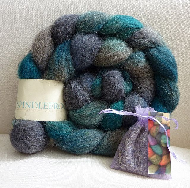naturally coloured grey Shetland roving has been overdyed by hand and was from Spindlefrog