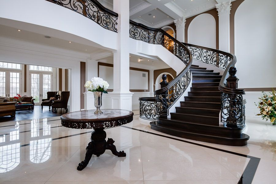 Foyer staircase mansion interior saxony manor sells for 6 2 million beautiful homes - Amazing private house design with luxurious swirly white staircase ...