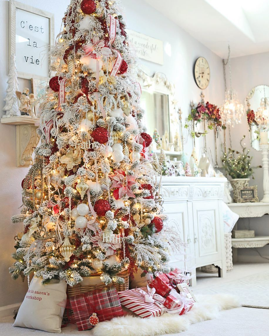 flocked tree with red ornaments Holiday Decor