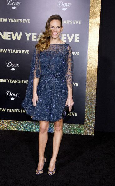 Hilary Swank Beaded Dress  Hilary Swank looked like a modern day princess in a glittering midnight blue cocktail dress for the 'New Year's Eve' premiere.  Brand: Elie Saab