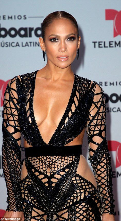 08d29d822ff Took the plunge  Jennifer Lopez rocked a fishnet dress with plunging  neckline Thursday at the Billboard Latin Music Awards in Florida