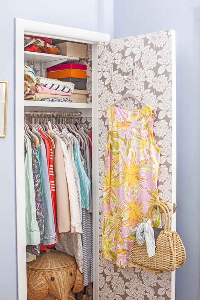 organized closet with wallpaper // Matchbox Mag. Jane Lilly Warren's Manhattan rental apartment. Wallpaper inside of a closet door.