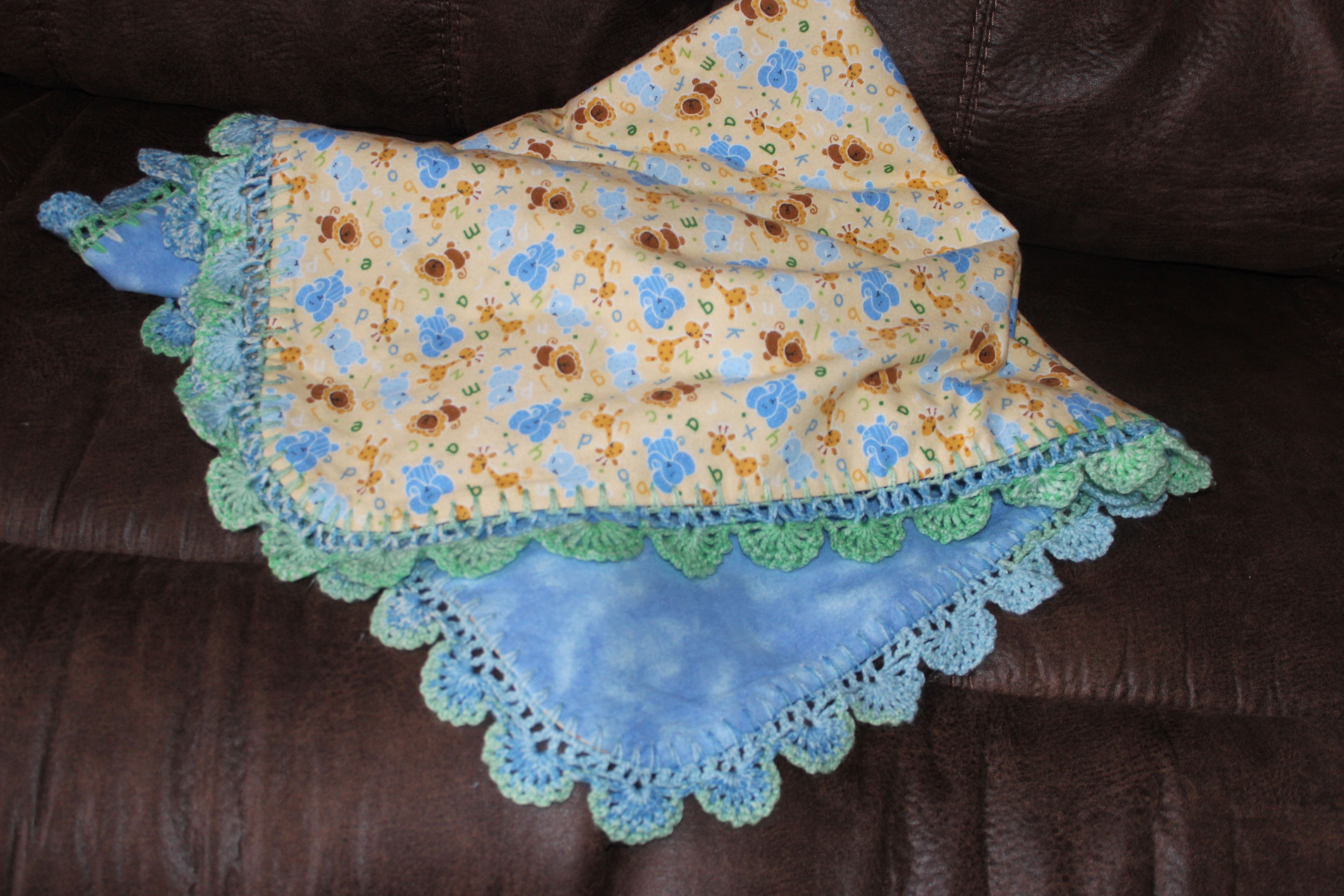 Crocheted edging on a flannel blanket.  I have made one for each of my grandchildren.  There are a wonderful weight!!! http://www.ravelry.com/patterns/library/edging-6