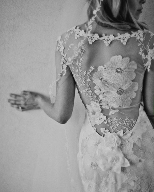 never plan to divorce and remarry, but that sure is a lovely backpiece on a wedding dress!