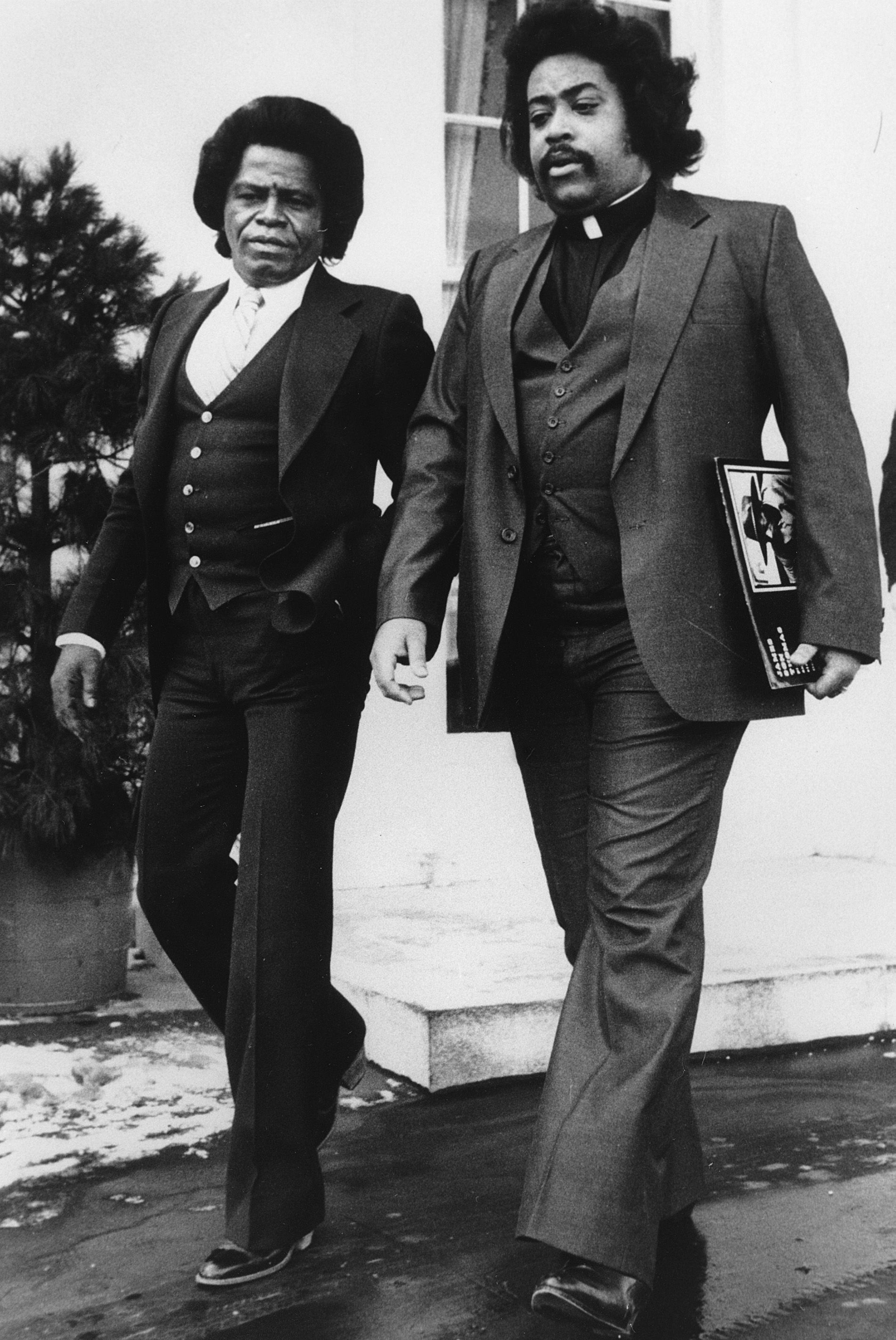 Reverend Al escorts the Godfather of Soul from the White House