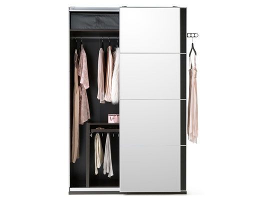 A black brown IKEA fitted wardrobe with sliding mirrored doors