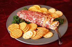 Dried Beef Log: 8 oz cream cheese, 1/4 cup grated Parmesan, 1 T prepared horseradish, 13/ cup chopped stuffed green olives, 2.5 oz dried beef, finely snipped. Blend all ingredients except beef. Shape into two 6 inch rolls. Chill overnight. Roll each log in beef.