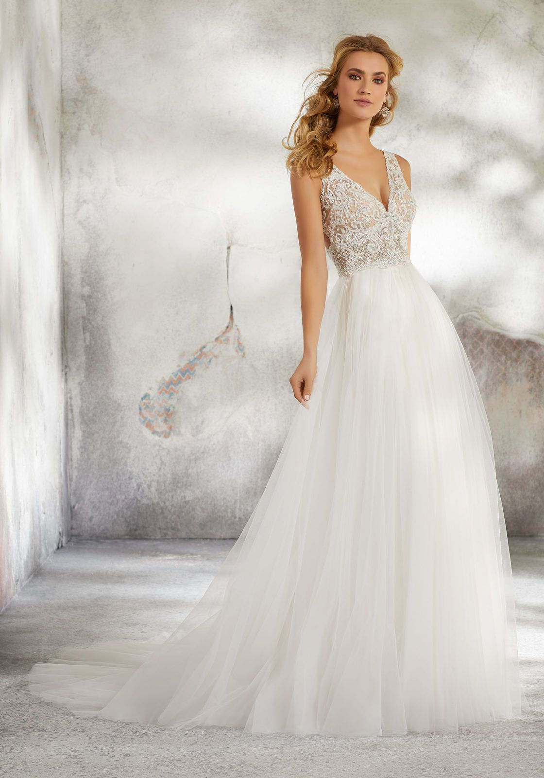 a602ac7d9eee Dreamy Bridal Ballgown Featuring a Soft Tulle Skirt and Crystalized  Embroidered V-Neck Bodice. An Open Keyhole Back with Covered Buttons  Completes the Look.