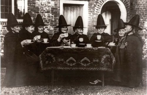 Old women (dressed as Witches) having Tea by unknown photographer