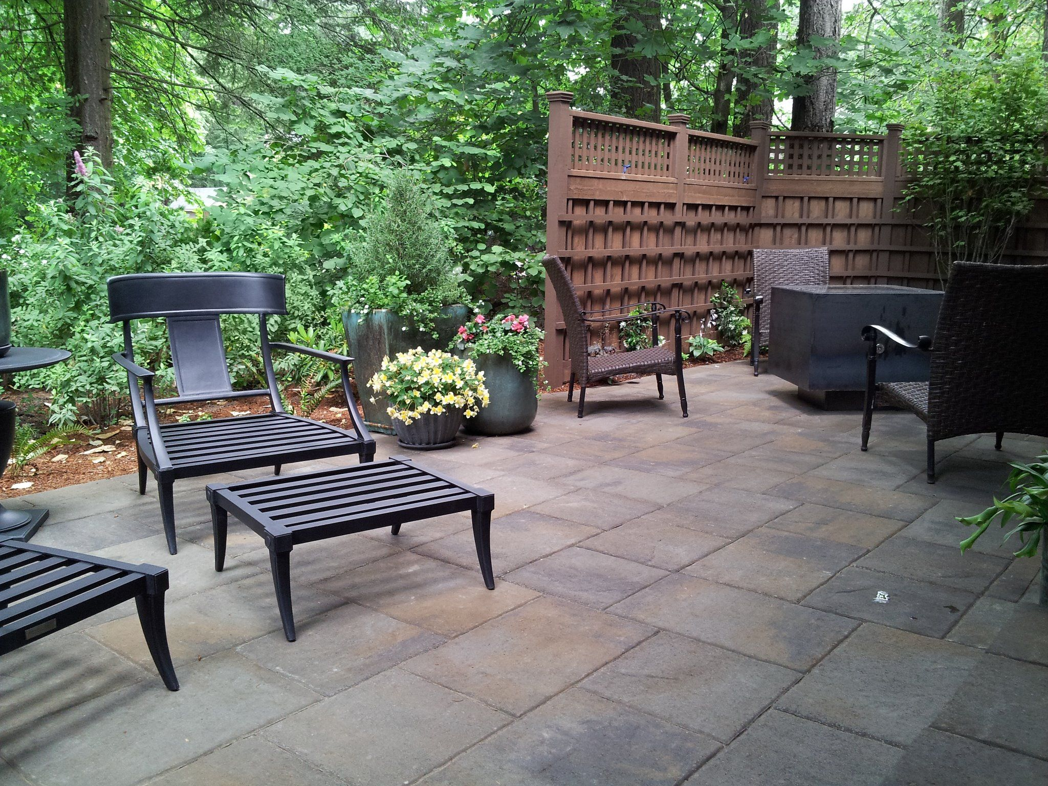 Belgard lafitt rustic slab patio with custom fencing and for Rustic outdoor privacy screens