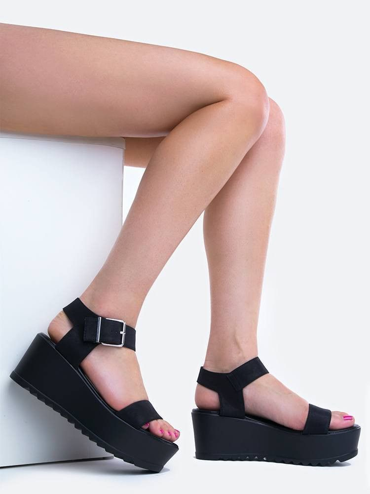 ba2192c6fe713 Take comfy cloud like steps with these platform sandals! - Features a vegan  leather upper with a wide ankle strap and buckle closure on the side.