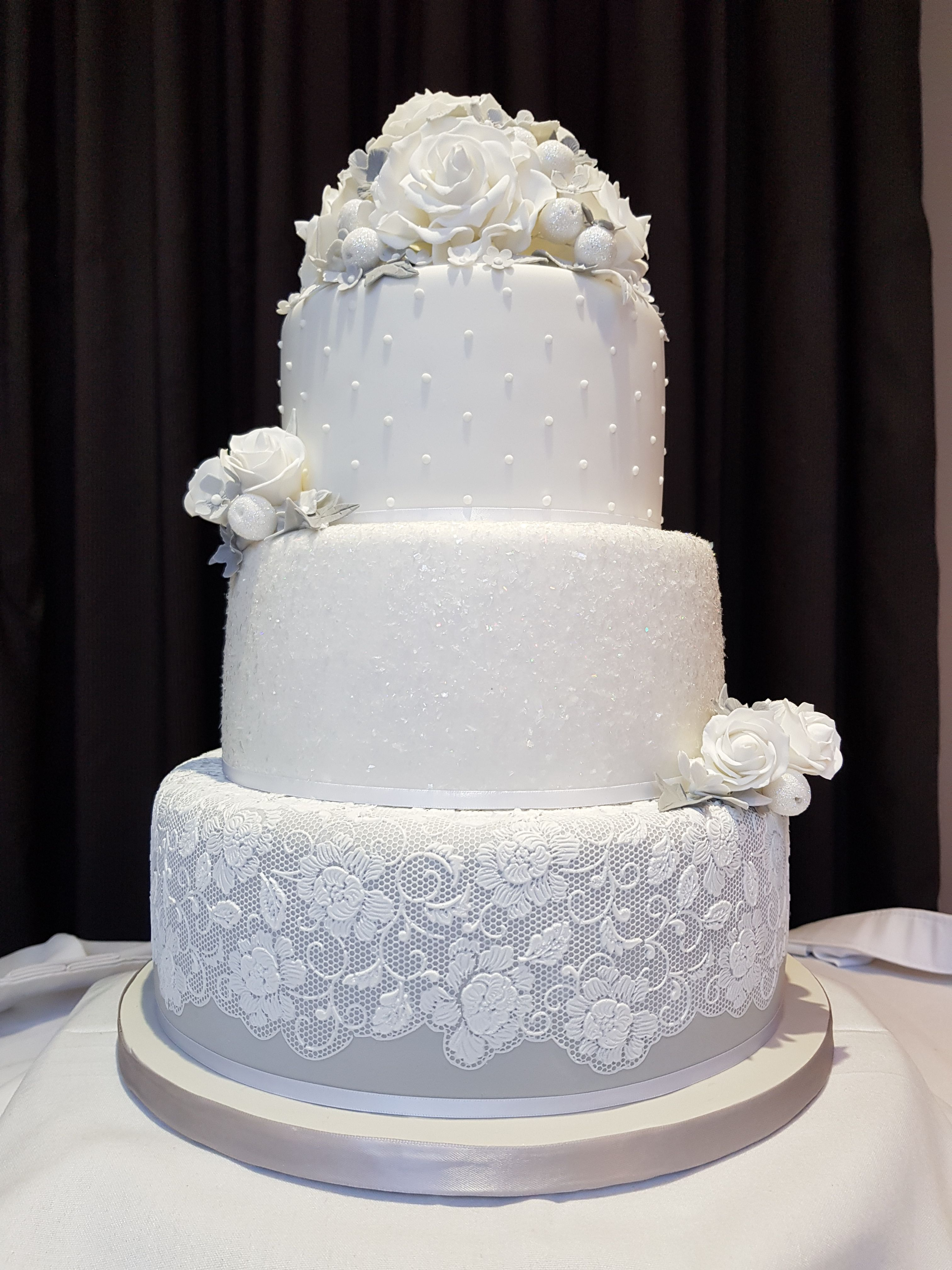 Winter silver and grey wedding cake with lace and sugar flowers