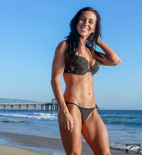 Beautiful Brunette Surf Girl Bikini Swimsuit Model Goddess @ Manhattan Beach! Pro Body Builder and professional fitness model! A classical athletic goddess with amazing muscle tone -- great abs and legs and amazing calves!  Like my new facebook! www.