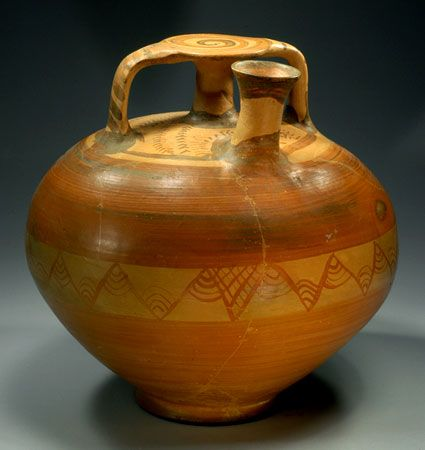 MYCENAEAN LARGE POTTERY STIRRUP JAR  The body with a band of zig-zags with four arc at each right angle; the top with dotted lines. In unusually fine condition for a vase of this size.  Ca. 1400 BC