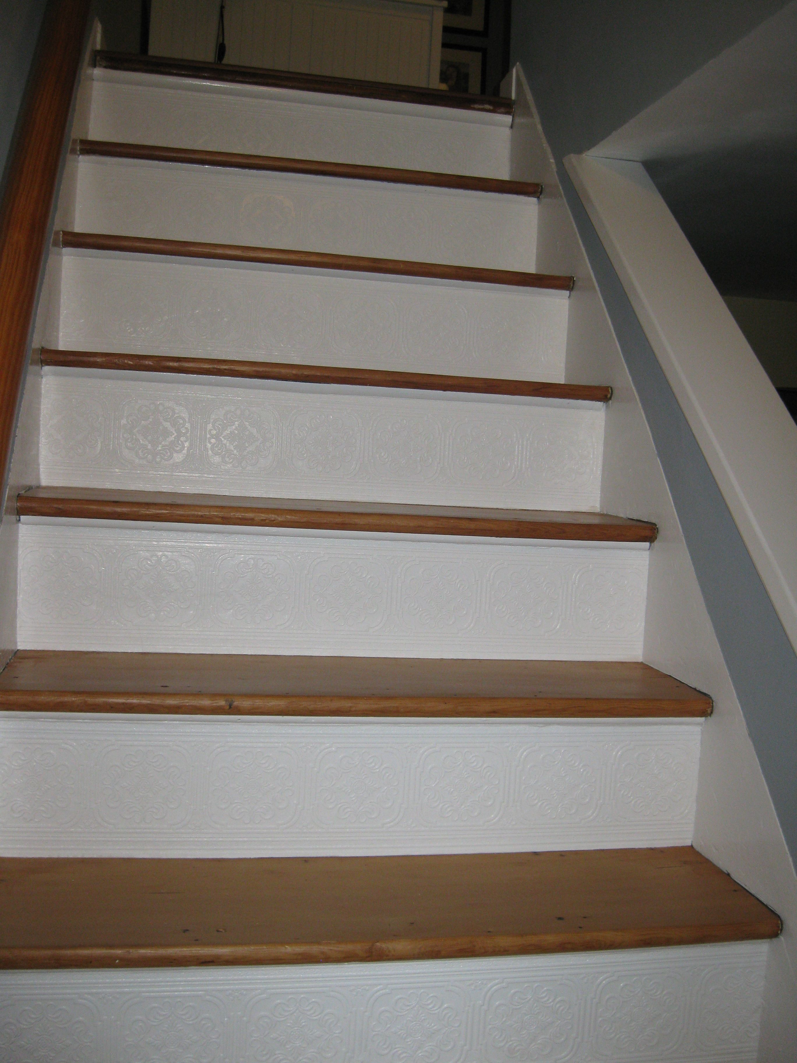 Stair Risers Finished With Paintable, Textured Wallpaper Border.