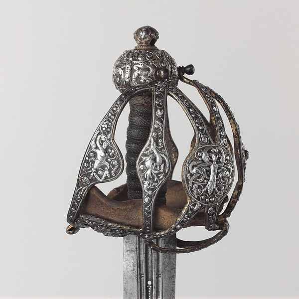 Basket-Hilted Sword Date: 1600–1625 Culture: British Medium: Steel, silver Dimensions: L. 39 3/8 in. (100 cm); L. of blade 33 in. (83.8 cm); greatest W. 5 3/4 in. (14.6 cm); greatest W. of blade 1 11/16 in. (4.3 cm); greatest D. of blade, 3/16 in. (0.5 cm); Wt. 3 lb. 13 oz. (1729 g)