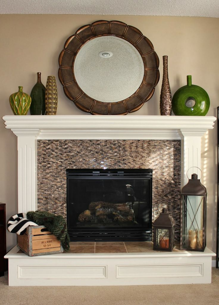 Amazing transformation. Check out Sarah's DIY Fireplace