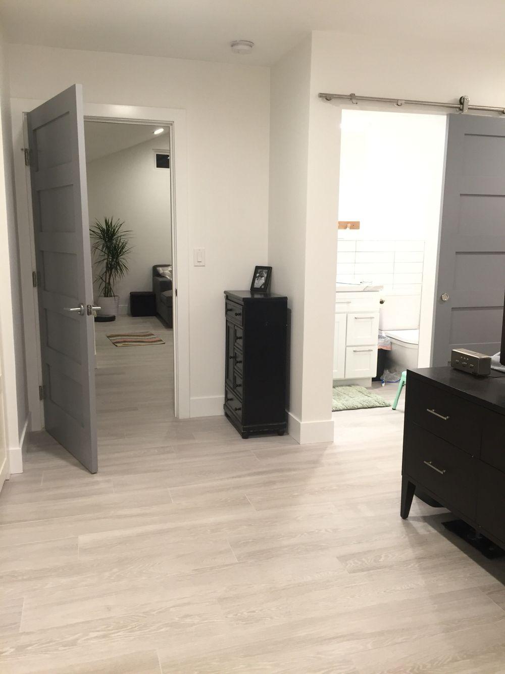 Master Bathroom Barn Door wood grain tile. master bathroom. gray barn door | our house
