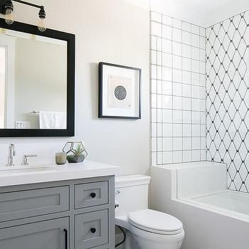 shower and tub combo with black and white diamond pattern