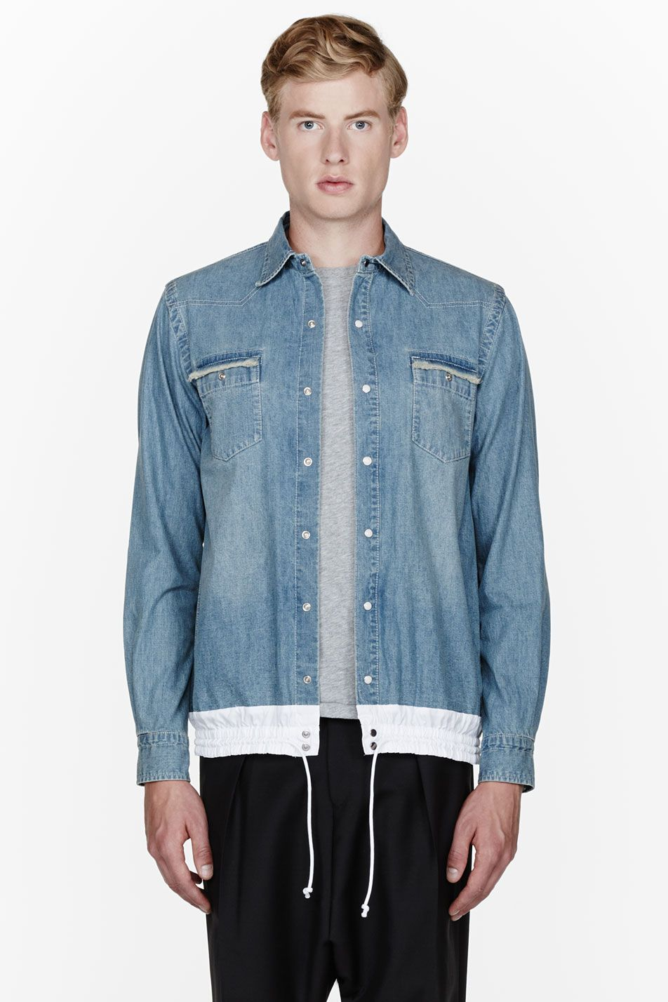 SACAI //  Blue drawstring hem denim shirt  32445M040001  Long sleeve lightweight denim shirt in pale blue. Spread collar. Press-stud closure and frayed flap pockets at front. Contrasting elasticized hem in white with tonal drawstring. Contrast stitching in white. Single press-stud at barrel cuffs. Body: 100% cotton. Trim: 100% polyester. Hand wash. Imported.  $405 CAD