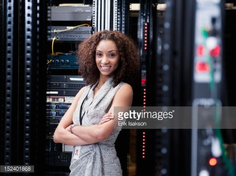 Stock Photo : Black businesswoman standing in server room
