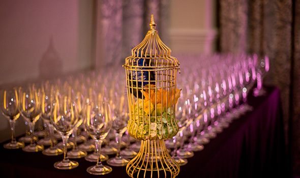 gold birdcage with flowers