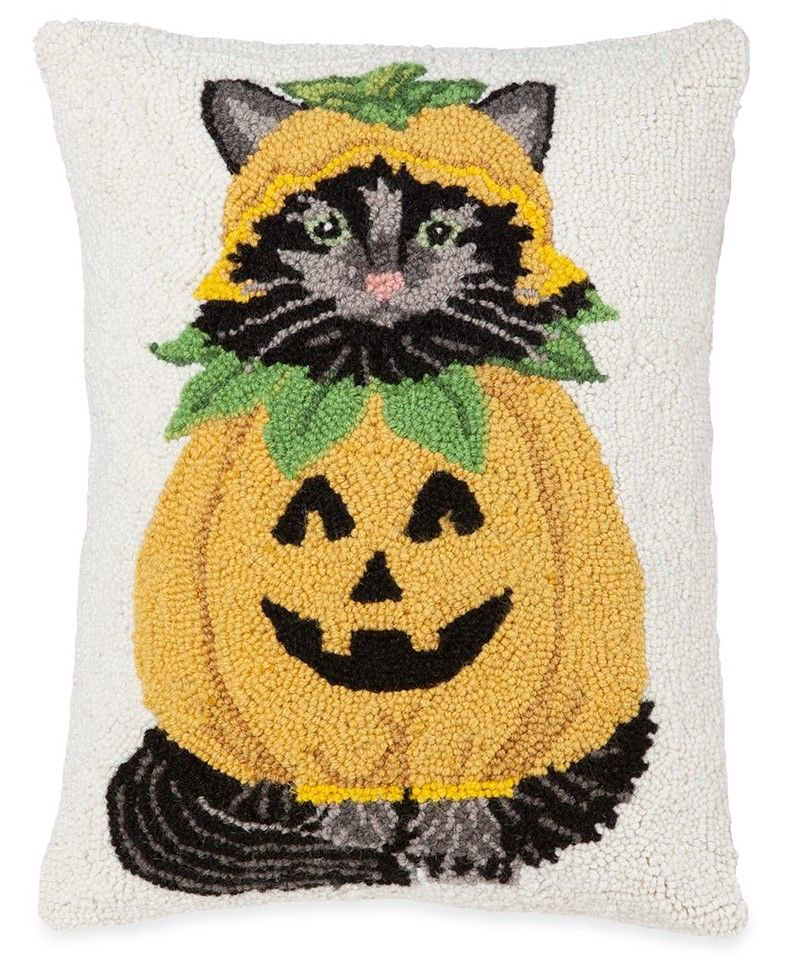This hooked wool pillow adds whimsy to your seasonal décor