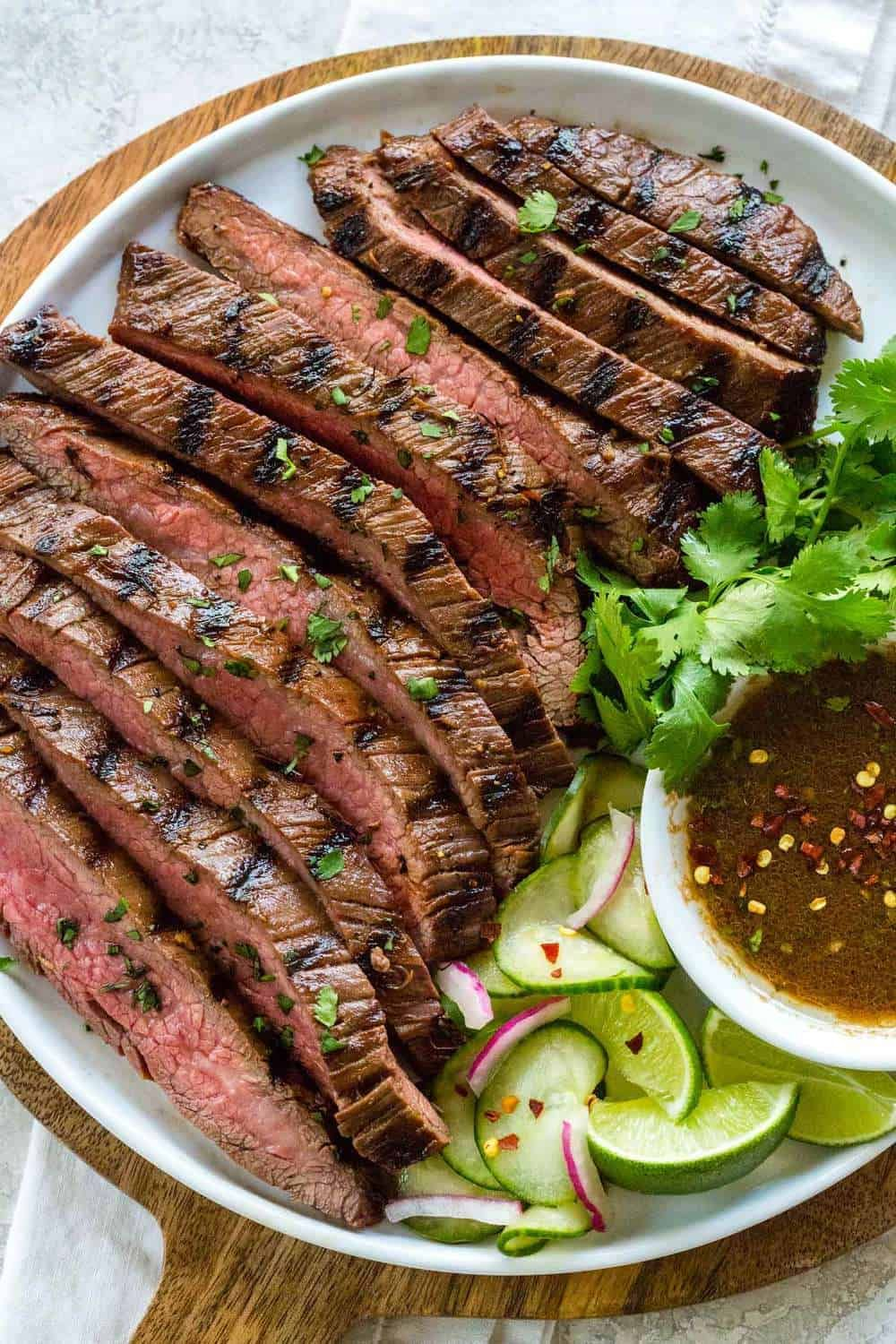 Grilled Flank Steak Marinated In A Bold Asian Inspired Mixture Of Soy Sauce Ginger Garl Flank Steak Recipes Grilled Flank Steak Recipes Grilled Steak Recipes