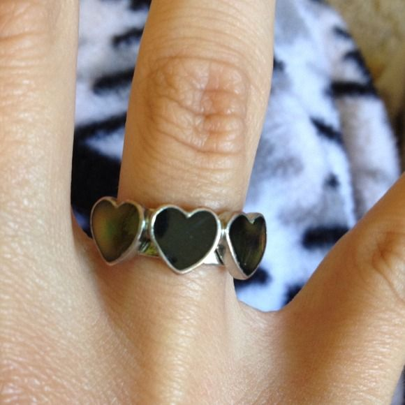 Mood ring The only one that dosnt chance colors is the one in the middle Jewelry Rings