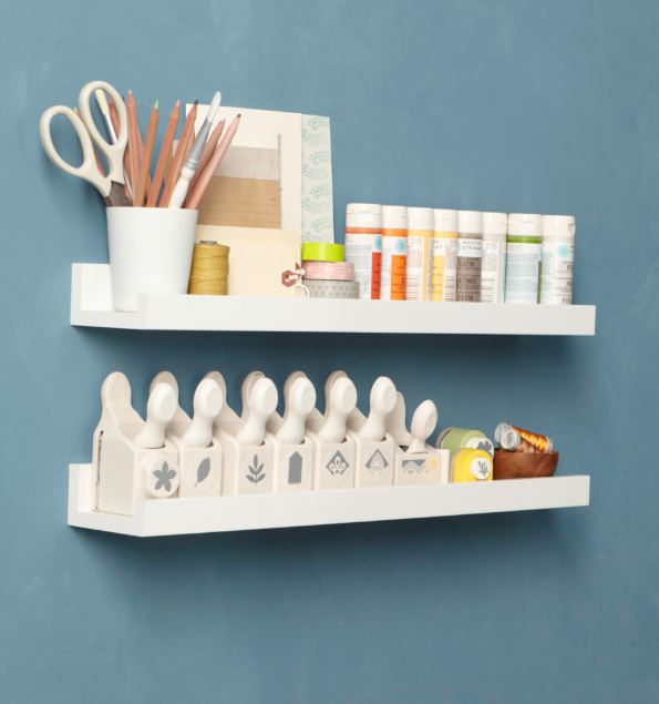 Use shallow IKEA Ribba picture ledges to organize craft supplies.
