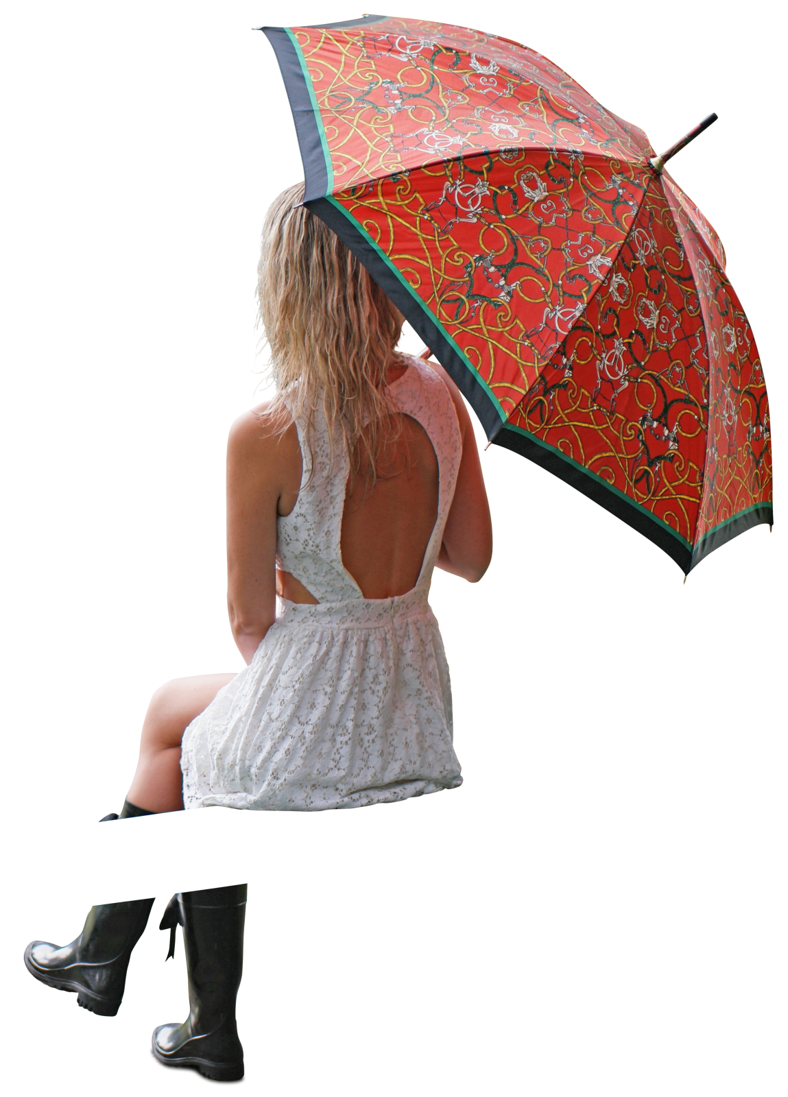 Woman in dress sitting with colourfull umbrella by