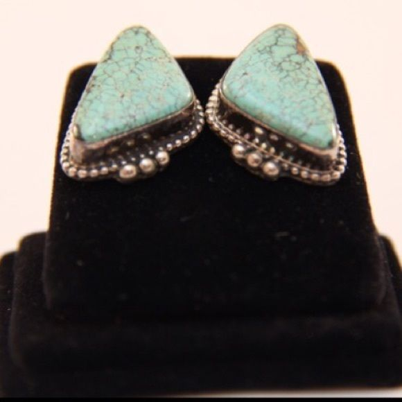 """Vintage Turquoise Earrings This pair of old pawn,Accented in a sterling silver base with hand etched design, this Native American pair of earrings looks trendy alone or makes a fashion statement perfecting accenting its Squash blossom turquoise necklace. Signed and stamped Sterling. WEIGHT  0.3oz MEASUREMENTS 1"""" x 0.5""""  DESCRIPTION These earrings are Native American Jewelry Earrings"""