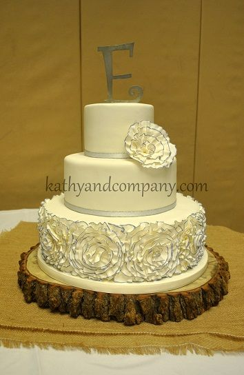Fondant ruffle wedding cake with painted purple accents.