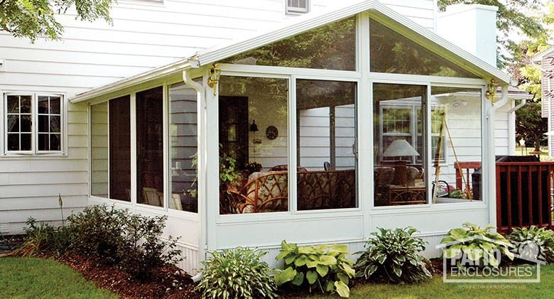 White Four Season Room With Gable Roof. Sunroom Ideas Photos. Discover More!
