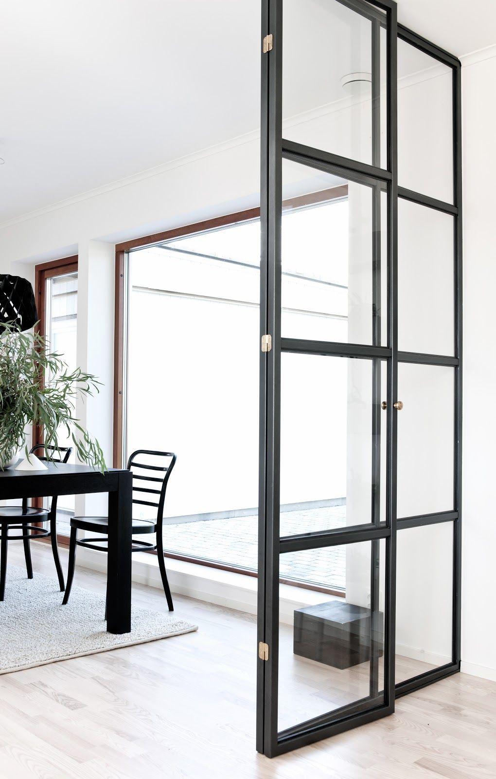 Steel framed minimal profile doors styling by annaleena nordic