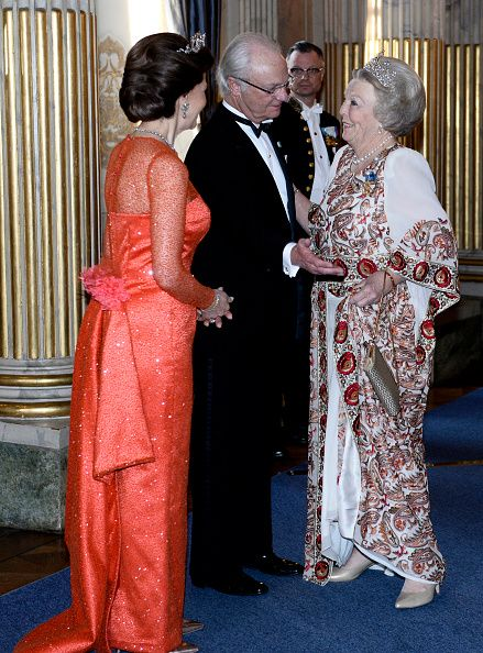 Sweden's Queen Silvia, King Carl Gustaf and Princess Beatrix of the Netherlands attend a Banquet at the Royal Palace in connection with The King's birthday celebrations, in Stockholm, on April 30, 2016.