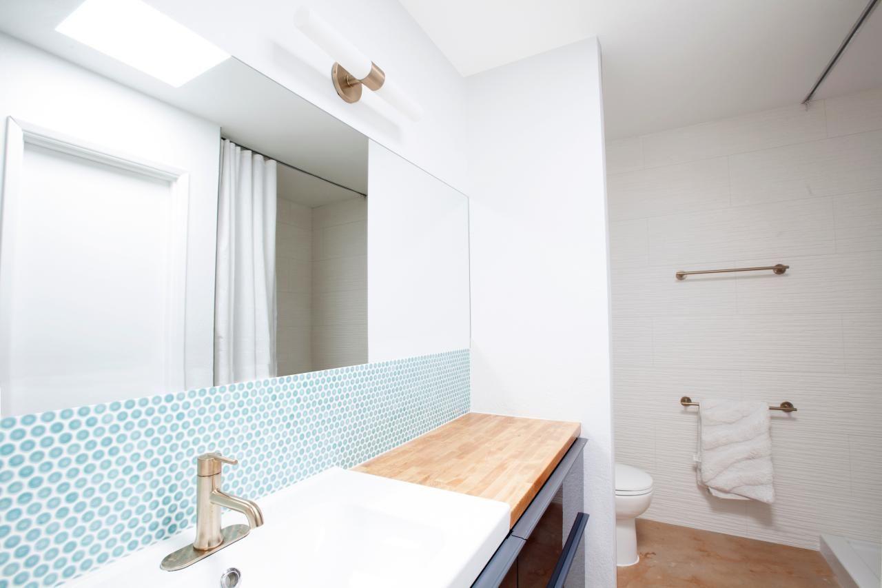 White Bathroom Vanity With Blue Mosaic Tile Backsplash | HGTV ...